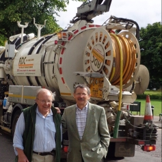 JDJ and Mike Mason in front of the sludge gulper which finally sorted out the High Street flooding problems